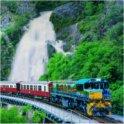 """<p>帰りは125年の歴史を誇るキュランダ列車で帰ってきます。日本のテレビ番組""""世界の車窓から""""でもオープニングを10年務めていた由緒正しき列車です。</p> <p>※その日の人数や各交通機関の関係から、スカイレールと列車の順番が入れ替わる場合もございますので、予めご了承ください。</p>"""